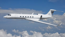 Gulfstream V flying in the blue sky - Guardian Jet